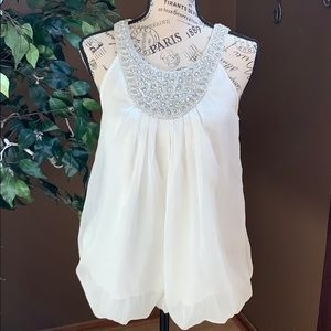Flowy white tank with embroidery and beading